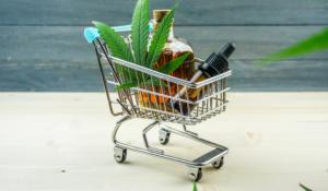 cbd products with marijuana leaf in trolley
